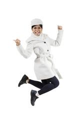 Woman smiling at camera while jumping
