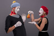 Portrait of funny mime couple with white faces and emotions isol