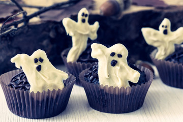 Halloween treats, chocolate muffins with  sweet white chocolate