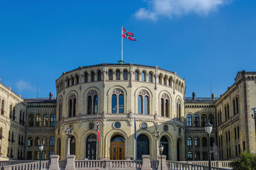 Norwegian parliament (Stortinget) with flag of Norway, Oslo