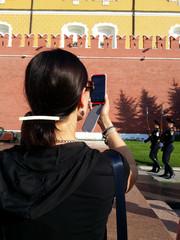 Women shoot with cellphone