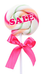 Sale concept. Colorful lollipop with bow isolated on white