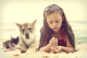 Child and puppy and kitten
