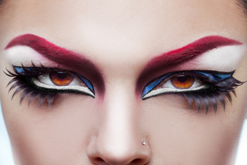 Close up photo of womans eyes with make up and healthy skin