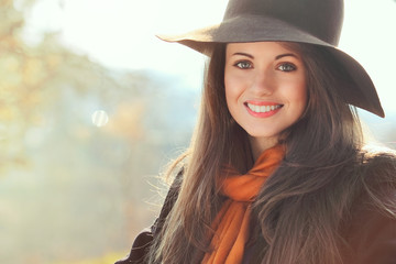 Smiling girl in autumn clothing