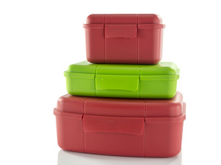 stack of red and green lunchboxes
