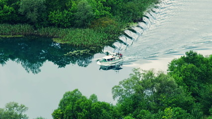 Boat floats Krka river