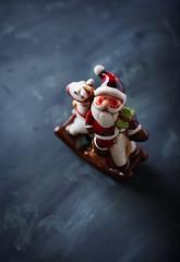 Ceramic Santa Claus on black background