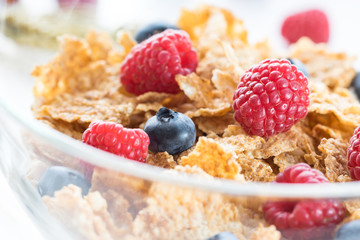 Cereal flakes with fresh raspberry closeup
