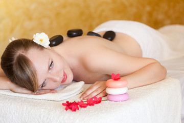 Beautiful  Young Woman Getting Hot Stone Massage