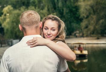 Love couple near the pond