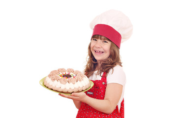 happy little girl cook with sweet cake