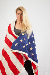 Blond woman wrapped in American flag