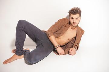 hot man lying on white background