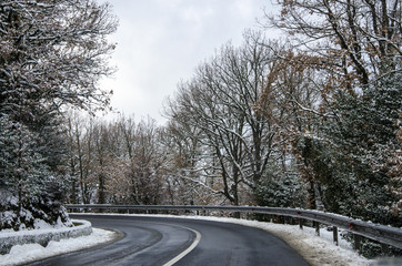 snowy mountain road snow cleared with trees