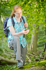 Hiker Using GPS Navigation in a Forest