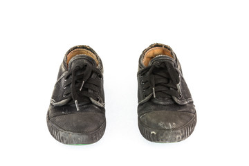 Old children sneakers on white background