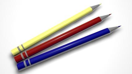 Trois crayons de couleur