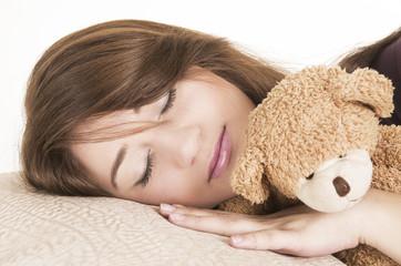 beautiful young brunette girl sleeping