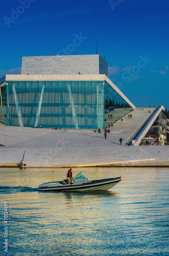 Motorboat floating in front of opera house in Oslo, Norway - 70124899