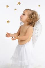 Christkind mit Sternen