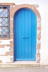Closed blue door in a italian alley