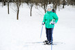 Little girl skiing on cross country skis