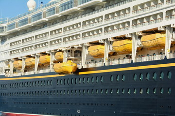 Life boats on the side of a cruise ship