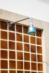 Silver shower head near swimming pool