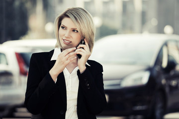 Young business woman calling on the cell phone