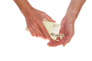 Hands pouring seeds