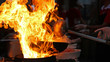 Chef Cooking With Fire In Frying Pan - 70129859