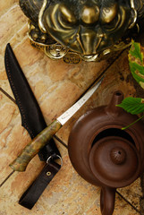 Knife and teapot