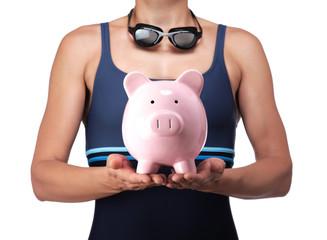 swimmer holding a piggy bank
