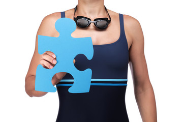 swimmer holding a piece of puzzle