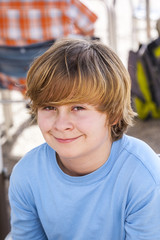 outdoor portrait of relaxed cute young boy