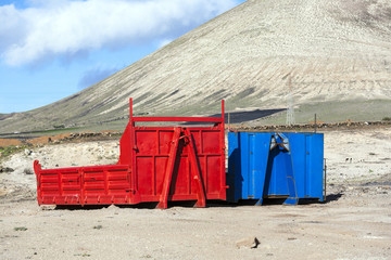 container pollute volcanic landscape in Lanzarote