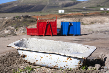 bath tub and container pollute volcanic landscape