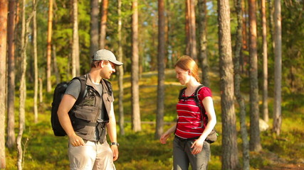 Young happy tourists in forest.
