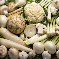 Decorative white colored vegetables background