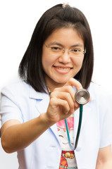 Happy female doctor holding out stethoscope