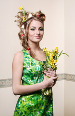 Spring girl holding bouquet of daffodils