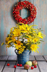 Bouquet of sunflowers and wild flowers on wooden table