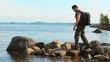 Young tourists on lake coast.