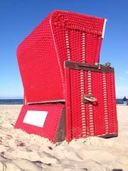 red beach chair at the sea