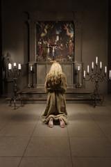 Sinner prays in a church