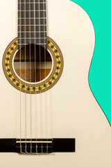 Classical white acoustic guitar fragment