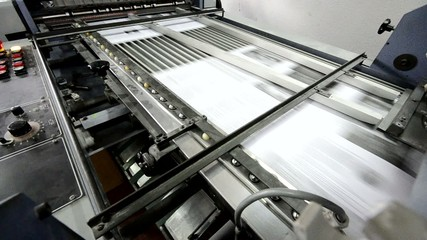 Machine Folding Paper in Action