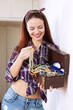 happy housewife with jewelry in treasure chest