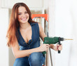 Happy sexy girl with drill